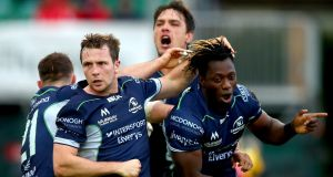 Connacht's Caolin Blade, Quinn Roux and Jack Carty celebrate with try-scorer Niyi Adeolokun during the game against Scarlets at the Showground. Photograph: James Crombie/Inpho