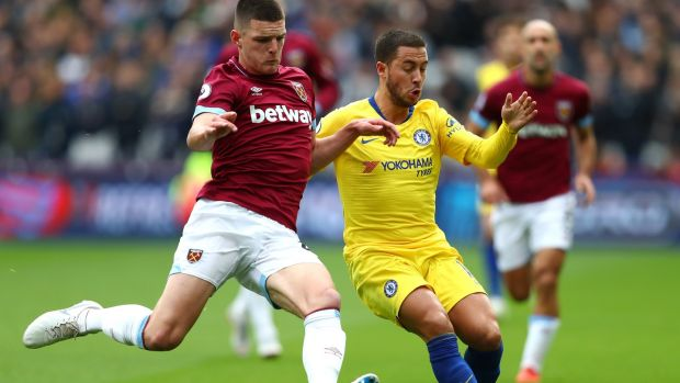 Declan Rice tackles Eden Hazard during West Ham's goalless draw with Chelsea. Photograph: Dean Mouhtaropoulos/Getty