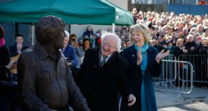 President  Higgins and his wife  Sabina react as the 'Big Tom' McBride statue is unveiled in Castleblaney, Monaghan as the 'Big Tom' festival concluded.   Photo Nick Bradshaw for The Irish Times