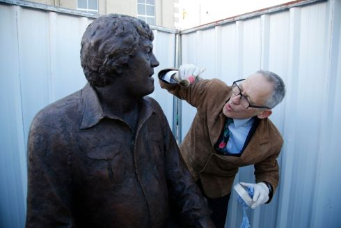 Sculptor Mark Richards completes the final finishing touches before the unveilling.  Photo Nick Bradshaw for The Irish Times
