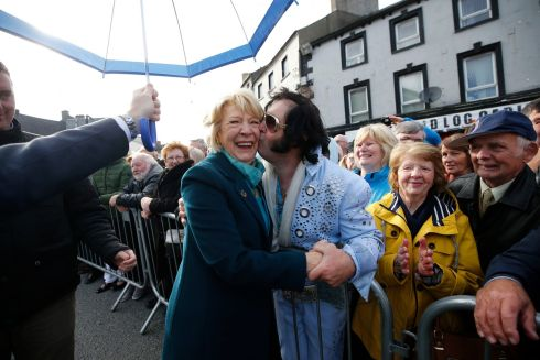 Sabina Higgins meeting 'Kilkenny Elvis' Myles Kavanagh in the town's square.  Photo Nick Bradshaw for The Irish Times