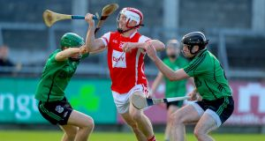 Cuala's Con O'Callaghan is challenged by Paul Rigney and Ronan Smith of Lucan Sarsfields. Photograph: Oisin Keniry/Inpho