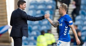Rangers manager Steven Gerrard shakes hands with  Scott Arfield after the  match at Ibrox. Photograph: Ian Rutherford/PA Wire.