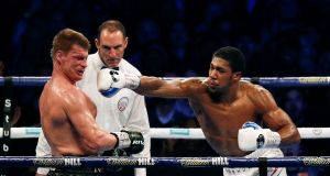 Alexander Povetkin is knocked down by   Anthony Joshua  in the seventh round of  their  world heavyweight title fight at Wembley Stadium. Photograph: Getty Images