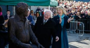 President Michael D Higgins and Sabina admire the Big Tom statue in Castleblaney, Co Monaghan. Photograph: Nick Bradshaw