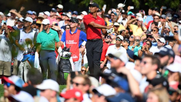 Tiger Woods plays his shot from the ninth tee during the final round of the Tour Championship.