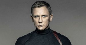Daniel Craig will take  the Aston Martin round the block one more time