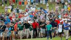 Crowds follow Tiger Woods up the 18th at East Lake. Photograph:  Kevin C. Cox/Getty