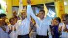Opposition presidential candidate Ibrahim Mohamed Solih (centre left) and his running mate Faisal Naseem (centre right)  celebrate their victory in the presidential election in Male, Maldives, on Monday. Photograph: Mohamed Sharuhaan/AP