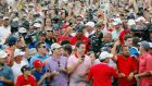 Tiger Woods surrounded by fans as he walks down the 18th in the Tour Championship. Photograph: evin C. Cox/Getty