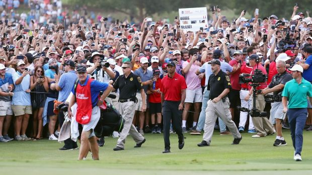 Fans flock to follow Tiger Woods down the 18th at East Lake. Photograph: Tim Bradbury/Getty