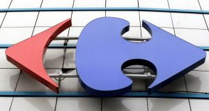 A Carrefour logo is seen on a Carrefour Hypermarket store near Paris. The supermarket group dneies making a merger approach to smaller rival Casino. Photograph: Regis Duvignau/Reuters