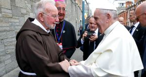 Pope Francis shaking hands with Br Kevin Crowley at the Capuchin Day Centre on Bow Street in Dublin, as part of his visit to Ireland last month. Photograph: Maxwell Photography/PA Wire