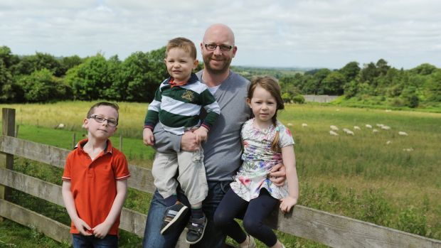 "Child psychotherapist Colman Noctor with his children, Odhran, Harry and Layla: ""Any parent who is human will raise their voice at their children from time to time."" Photograph: Aidan Crawley"
