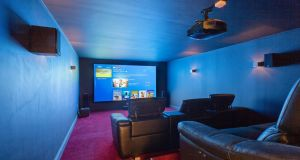 Main attraction: the home cinema room with a state of the art surround sound system and  mammoth 12ft screen