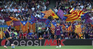 Barcelona fans with their Catalan flags at Camp Nou. Photograph: Albert Gea/Reuters