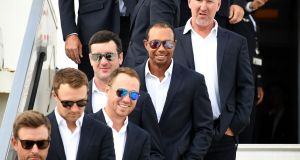 US golfer Tiger Woods and his Ryder Cup team mates arrive at Charles de Gaulle airport in Paris. Photograph: Getty Images