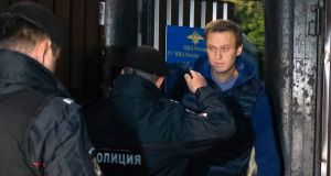 Russian police officers detain opposition activist Alexei Navalny as he leaves a detention centre  in Moscow. Photograph: AP Photo/Dmitry Serebryakov