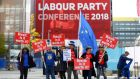 Anti-Brexit campaigners stand the Labour conference in Liverpool. Photographer: Simon Dawson/Bloomberg
