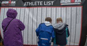 People read the list of athletes competing in the Wales Ironman.
