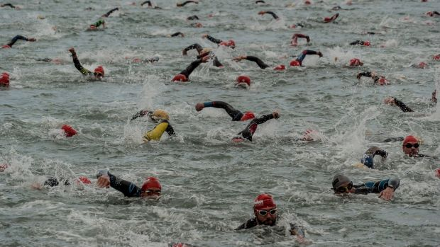 Competitors during the swimming portion of the Wales Ironman in Tenby.