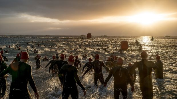 Competitors begin the swimming portion of the Wales Ironman in Tenby, Wales.