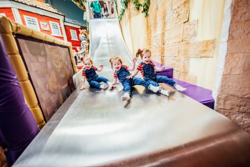 SLIDING DOWN: Triplets Courtney, Brooke and Alanna Martin age 3 from Rhebogue, Limerick pictured at the Prem Party at Dreamland, Limerick. The event reunited children who have graduated from the Neonatal Unit at University Maternity Hospital, Limerick. Photograph: Brian Arthur