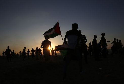 FLYING FLAG: Palestinian demonstrators carry national flags during a protest calling for an end to the Israeli blockade on Gaza, on a beach in Beit Lahia near the maritime border with Israel, on September 24th, 2018. Photograph: Said Khatib/AFP/Getty
