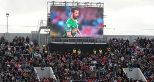 A tribute screen displaying photographs of Liam Miller above the stands during the tribute match at Páirc Uí Chaoimh, Cork. Photograph: Niall Carson/PA Wire
