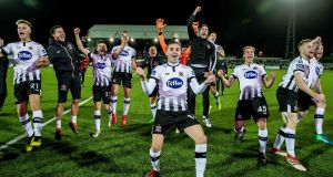 Dundalk players celebrate after beating Derry City in the SSE Airtricity League Premier Division game at Oriel Park. Photograph: Morgan Treacy/Inpho