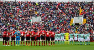 Man Utd Legends XI 2 Glasgow Celtic/Republic of Ireland XI 2 (Man Utd win 3-2 on penalties). The two teams stand for a minute's silence before the  Liam Miller tribute match at Páirc Uí Chaoimh in Cork, 25/9/2018. Photograph: Inpho/Tommy Dickson