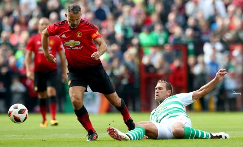 Manchester United's Ryan Giggs and Stilyan Petrov of Celtic & Ireland. Photograph: Inpho/James Crombie