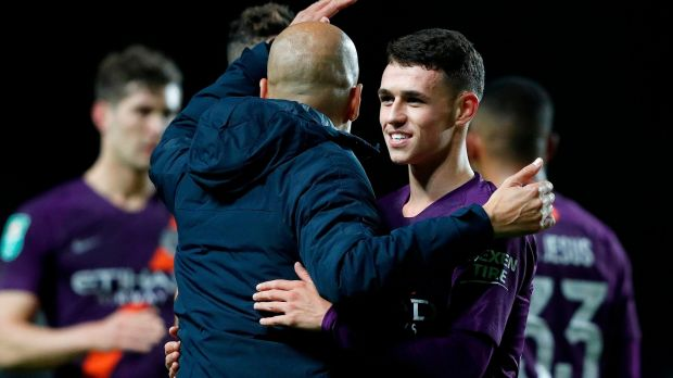 Manchester City's Catalan manager Pep Guardiola with Phil Foden after his team's League Cup win. Photograph: Getty Images