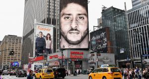 A Nike Ad featuring American football quarterback Colin Kaepernick on display in New York last month. Photograph: Angela Weiss/AFP