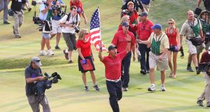 Anthony Kim of the USA celebrates with an American flag after the USA 16 1/2 - 11 1/2 at the 2008 Ryder Cup in Kentucky. Photo: Ross Kinnaird/Getty Images