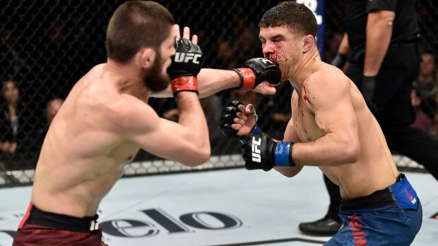 Khabib Nurmagomedov punches Al Laquinta in their lightweight title bout during the UFC 223 event. Photo: Jeff Bottari/Zuffa LLC/Zuffa LLC via Getty Images