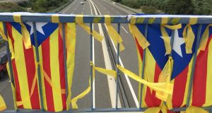 Pro-independence flags on bridge over Catalonia's AP7 motorway. Photograph: Guy Hedgecoe