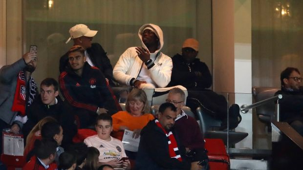 Pogba watches the match from the stands during United's Carabao Cup loss to Derby County. Photo: Andrew Boyers/Reuters