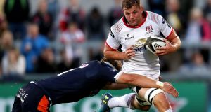 Ulster's Jordi Murphy goes past Jamie Ritchie of Edinburgh during their Pro14 clash. Photo: Bryan Keane/Inpho