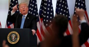 Donald Trump takes a question  during a news conference on Wednesday. Photograph: Reuters/Carlos Barria