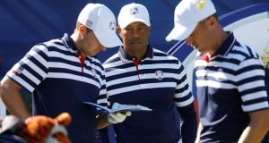 Team USA's Tiger Woods with his Ryder Cup team mates during practice in Paris. Photograph: Charles Platiau/Reuters