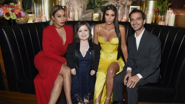 Sinéad Burke with the actor Lala Anthony, Kim Kardashian and the Business of Fashion founder Imran Amed in New York City. Photograph: Dimitrios Kambouris/Getty