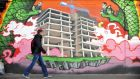 Graffiti depicts the stalled construction site of Anglo Irish Bank's proposed headquarters in Dublin following the bank's collapse.  Photographer: Aidan Crawley/Bloomberg via Getty Images