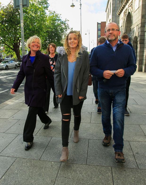 Rebecca Carter with her parents Annemaire and Niall leave the High Court in Dublin Photograph: Gareth Chaney/Collins