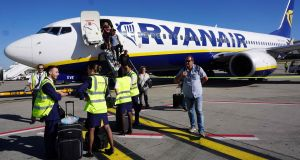 Ryanair crew waits as passengers disembark at Brussels South Charleroi Airport: If the UK crashed out of the EU without a deal, it would fall out of Open Skies. Photograph: Emmanuel Dunand/AFP