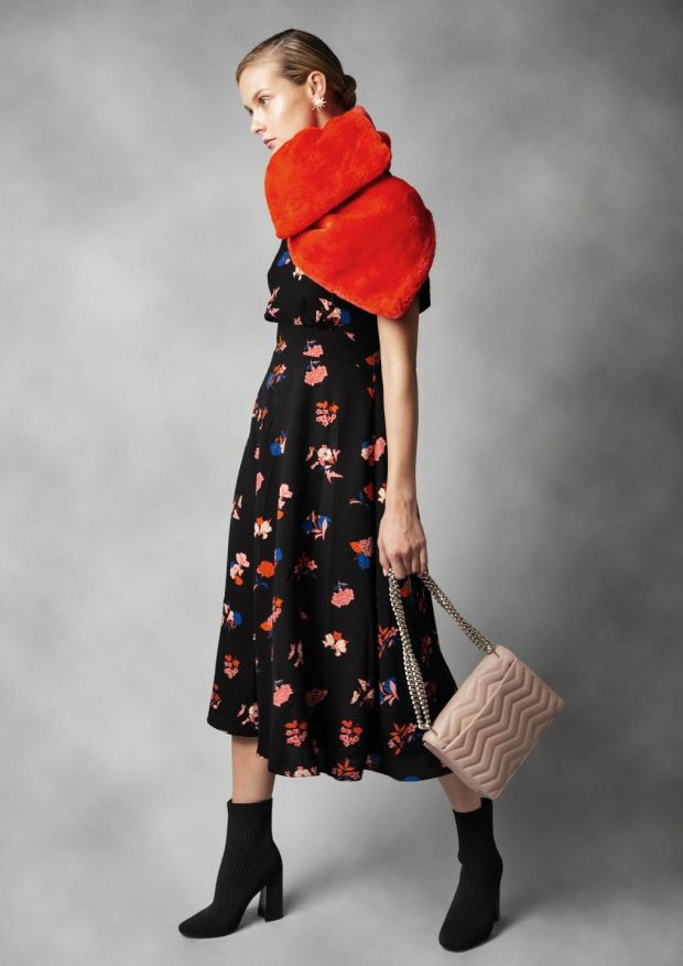 Black floral dress Essentiel Antwerp €249, red faux fur stole, Essentiel Antwerp €119, salmon leather bag Kate Spade, nova stud star earrings Lulu Frost at Loulerie €199, black sock boots Kendall & Kylie €225