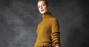 Mustard knit Fisherman Out of Ireland €205, long floral skirt Pablo €185, burgundy suede bag Coccinelle 350, crystal tulip hoop earrings Alexis Bittar at Loulerie €179, green suede boot, Jonak €165