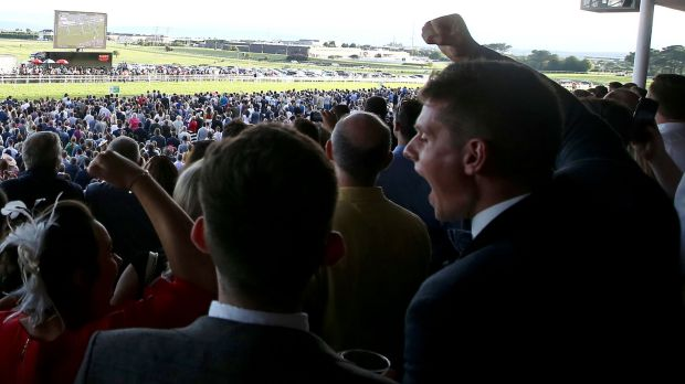Racegoers celebrate at the Galway Races in August. Attendances this year were 39% short of the 2006 peak. Photograph: Tommy Dickson/Inpho
