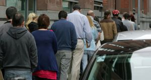 Jobseekers queuing for allowances in Dublin. The C & AG report found  under 25s receiving the allowance has dropped significantly to 30,019 since it peaked in October 2010 at close to 100,000. File photograph: Frank Miller