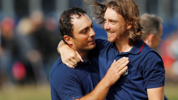 Francesco Molinari and Tommy Fleetwood celebrate after winning their morning fourballs match at the Ryder Cup at Le Golf National in Paris. Photograph: Paul Childs/Reuters